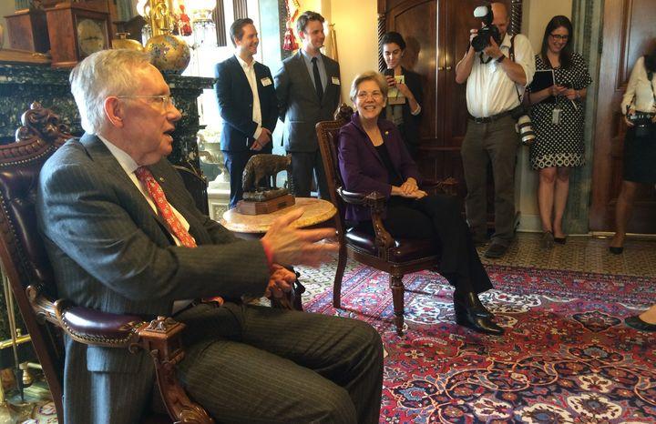 Senate Minority Leader Harry Reid (D-Nev.) and Sen. Elizabeth Warren (D-Mass.) spoke with progressive groups in the Capitol o