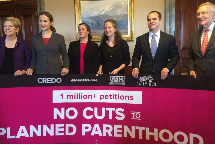 Sen. Elizabeth Warren (D-Mass.), Anna Galland (MoveOn.org), Rachel Colyer (Daily Kos), Heidi Hess (CREDO Action), Neil Sroka