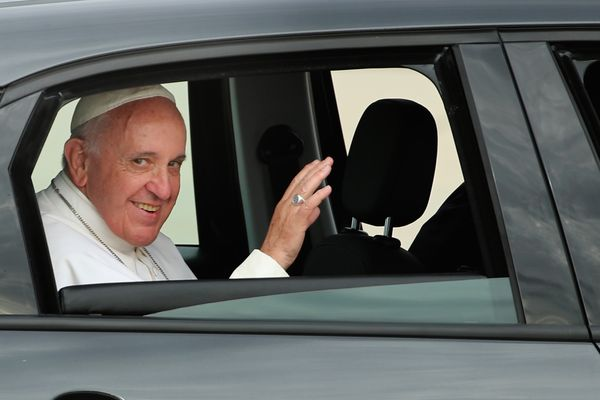 JOINT BASE ANDREWS, MD - SEPTEMBER 22:  Pope Francis waves from the back of his Fiat after arriving from Cuba September 22, 2