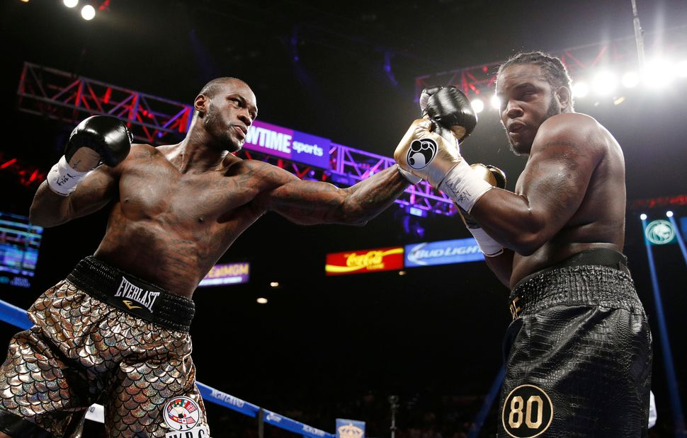 Deontay Wilder hits Bermane Stiverne during their WBC heavyweight title bout on Jan. 17 in Las Vegas.