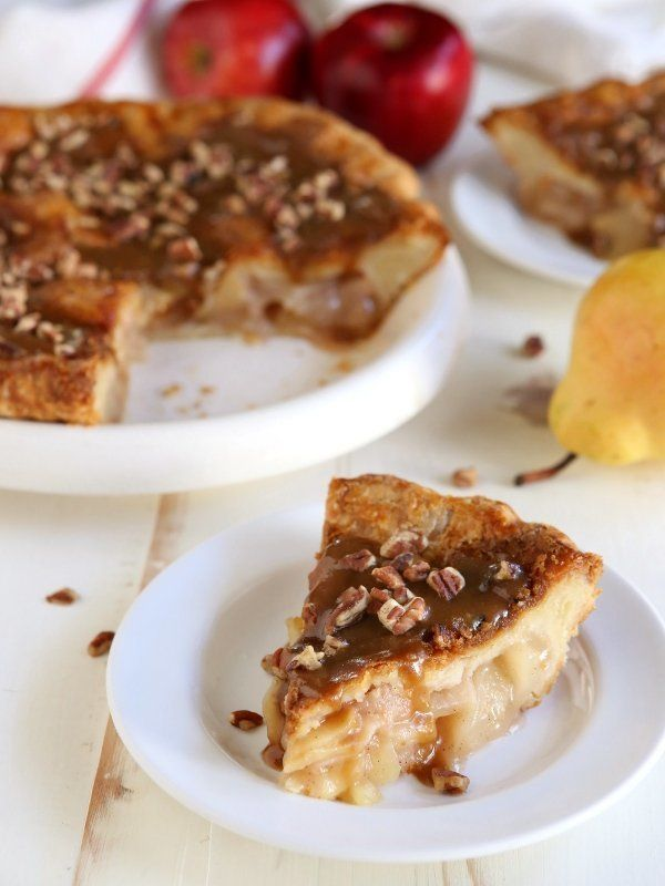 """<strong>Get the <a href=""""http://www.completelydelicious.com/2014/11/apple-pear-praline-pie.html"""" target=""""_blank"""">Apple Pear P"""