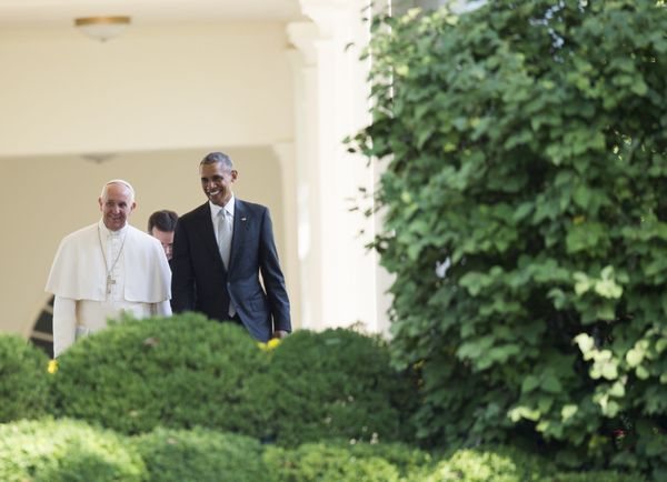 US President Barack Obama and Pope Francis walk down the West Wing Colonnade to a meeting in the Oval Office of the White Hou
