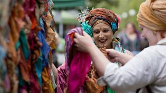 Claudia, of Zingari Tribal Belly Dance, chats with customer Sofie Watson at her booth during Pagan Pride Day in Louisville, Ky., on Sept. 12, 2015. Claudia teaches belly dancing in the American Tribal Style, a relatively new, eclectic dance genre that draws on a variety of cultural influences. Religion News Service photo by Lauren Pond