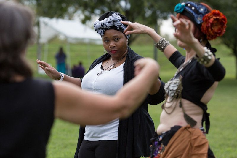 Lenay Clayton, of Evansville, Ind., participates in an impromptu belly dance lesson with Marie Geever, right, during Pagan Pr