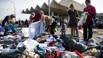HEGYESHALOM, HUNGARY - SEPTEMBER 23 :  Refugees receive clothes and shoes in Hegyeshalom on September 23, 2015. (Photo by Arpad Kurucz/Anadolu Agency/Getty Images)