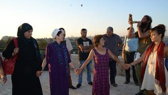 Two dozen people of various faiths gathered on Sept. 21, 2015, for a meeting and interfaith peace walk between the eastern and western parts of Jerusalem. Elana Rozenman, Abrahamic Reunion co-founder and founder of TRUST-Emun, appears second from left.