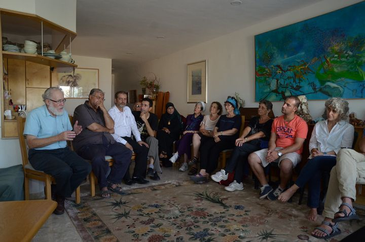 An interfaith group gathered in a private home on Sept. 21, 2015, to defuse potential tensions over how Jews and Muslims cele