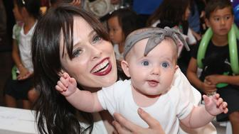 NEW YORK, NY - SEPTEMBER 10:  Model Coco Rocha with daughter Ioni James Conran attend Paul Frank Industries Kid's Show  Front Row during Spring 2016 New York Fashion Week at Hudson Mercantile on September 10, 2015 in New York City.  (Photo by Robin Marchant/Getty Images)
