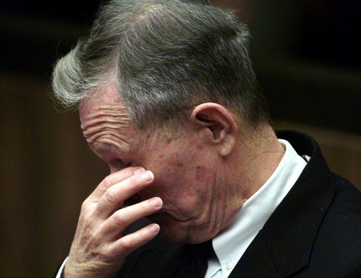 Roman Catholic priest John Geoghan listens to Judge Sandra Hamlin at Middlesex Superior Court in Cambridge, Massachusetts, 21