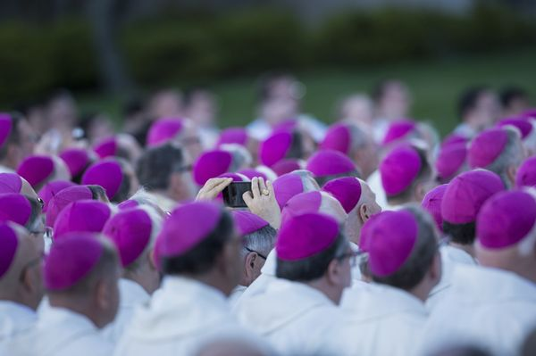 People listen during a Canonization Mass with Pope Francis for Rev. Junipero Serra at the Basilica of the National Shrine of
