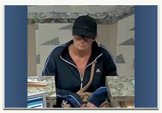 Surveillance image of suspect Nicole Gillespie.