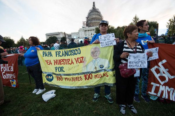 Immigration reform activists hold a banner in front of the US Capitol in Washington, DC.