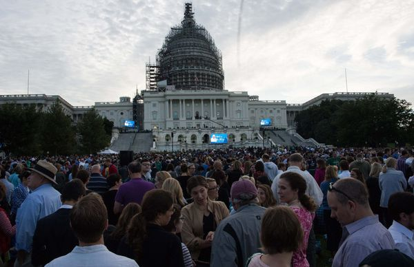 People gather in front of the US Capitol in Washington, DC, on September 24, 2015 before Pope Francis addresses a Joint Sessi