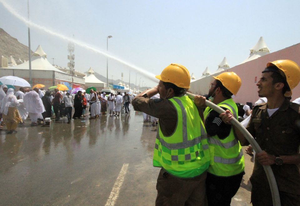 Emergency personnel spray water to cool down hajj pilgrims at the site of a stampede in Mecca, Saudi Arabia, on Sept. 24, 201
