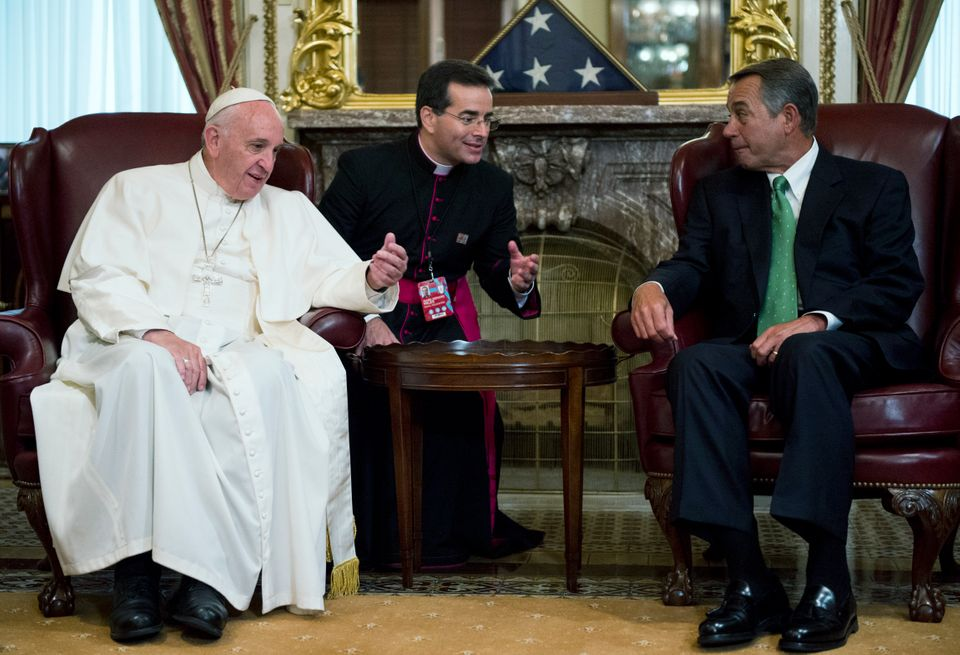Speaker of the House John Boehner(right)speaks with Pope Francis in the Capitol before the pontiff speaks to a jo