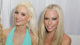INDIANAPOLIS, IN - FEBRUARY 04: (L-R) Bridget Marquardt, Holly Madison and Kendra Wilkinson attends the Ninth Annual Leather and Laces event at the Regions Bank Tower on February 4, 2012 in Indianapolis, Indiana. (Photo by Tasos Katopodis/Getty Images for Leather & Laces)