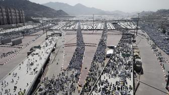 Muslim pilgrims arrive to throw pebbles at pillars during the 'Jamarat' ritual, the stoning of Satan, in Mina near the holy city of Mecca, on September 24, 2015. Pilgrims pelt pillars symbolizing the devil with pebbles to show their defiance on the third day of the hajj as Muslims worldwide mark the Eid al-Adha or the Feast of the Sacrifice, marking the end of the hajj pilgrimage to Mecca and commemorating Abraham's willingness to sacrifice his son Ismail on God's command in the holy city of Mecca. AFP PHOTO / MOHAMMED AL-SHAIKH        (Photo credit should read MOHAMMED AL-SHAIKH/AFP/Getty Images)