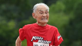 KYOTO, JAPAN - AUGUST 3: 103-year-old Japanese sprinter Hidekichi Miyazaki runs during men's 100m dash at a Japan Masters Athletics competition in Kyoto on August 3, 2014. Miyazaki, who holds the 100 metres world record for centenarians at 29.83 seconds and is dubbed 'Golden Bolt' after the Jamaican flyer, plans to wait another five years for his dream race and was happy to reveal his secret weapon: his daughter's tangerine jam.     AFP PHOTO/Toru YAMANAKA  (Photo credit should read Toru YAMANAKA/AFP/Getty Images)