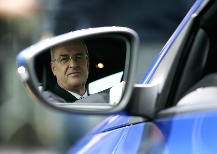 Martin Winterkorn looks in the rearviewmirror as he sits in the Volkswagen model 'Scirocco' during the company's annual