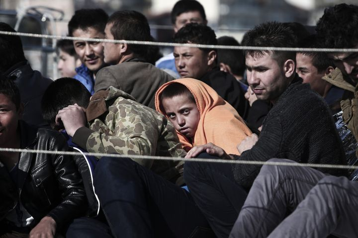 Refugees arrive on a Hellenic Coast Guard ship at the island of Lesbos. Since Greece bolstered controls along its land border