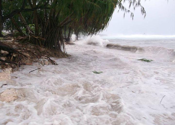 After a storm, flood waters gush toward Kiribati's mainland -- where Ioane Teitiota must return--on March 14. The