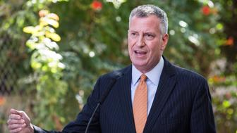 New York City Mayor Bill de Blasio (D) was among the mayors to urge the president to admit more Syrian refugees.  (Photo by Andrew Burton/Getty Images)