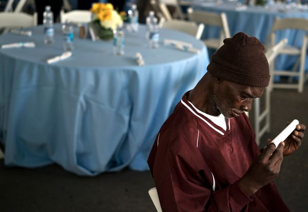 WASHINGTON, DC - SEPTEMBER 24: Michael White listens to hymns while waiting for Pope Francis to arrive and bless a meal outsi