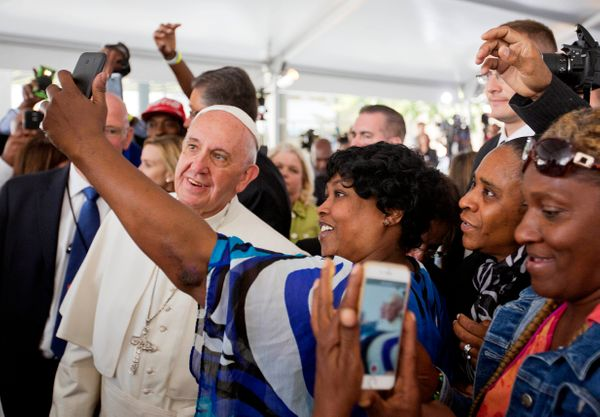 WASHINGTON, DC - SEPTEMBER 24: Cartrice Haynesworth, center, has a selfie taken with Pope Francis, left, as he walks through