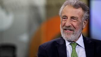 George Zimmer, founder of Men's Wearhouse Inc. and ZTailors, speaks during a Bloomberg Television interview in New York, U.S., on Tuesday, June 9, 2015. Zimmer discussed his new startup tailoring service ZTailors and his exit from Men's Wearhouse. Photographer: Chris Goodney/Bloomberg via Getty Images
