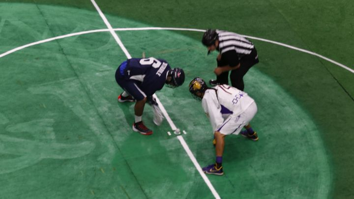 Jeremy Thompson of the Iroquois Nationals takes the faceoff against Team USA's CJ Costabile