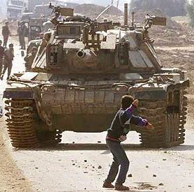 Faris Odeh, a fourteen-year-old boy, throwing stone at an Israeli tank ten days before he was shot and killed for stone-throw