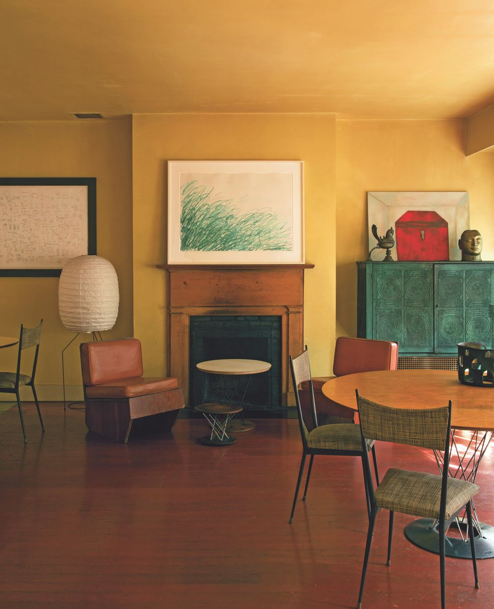 <strong>The home of Francesco Clemente:</strong> A drawing by Cy Twombly over the fireplace is flanked by a Jean-Michel Basqu