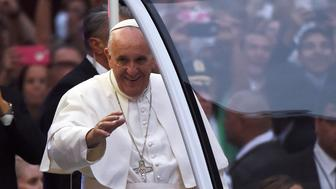 Pope Francis waves as he arrives at the St Patrick's Cathedral to lead evening prayers in New York on September 24, 2015. Pope Francis arrived in New York on the second leg of his US tour where he will address the UN General Assembly, visit the 9/11 Memorial and celebrate mass at Madison Square Garden. AFP PHOTO/JEWEL SAMAD        (Photo credit should read JEWEL SAMAD/AFP/Getty Images)