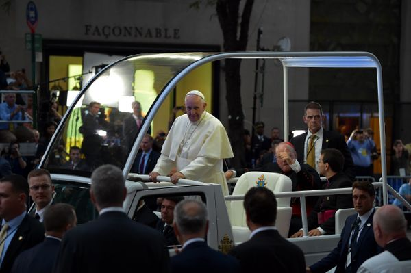 Pope Francis waves as he approaches St. Patrick's Cathedral to lead evening prayers in New York on September 24, 2015.