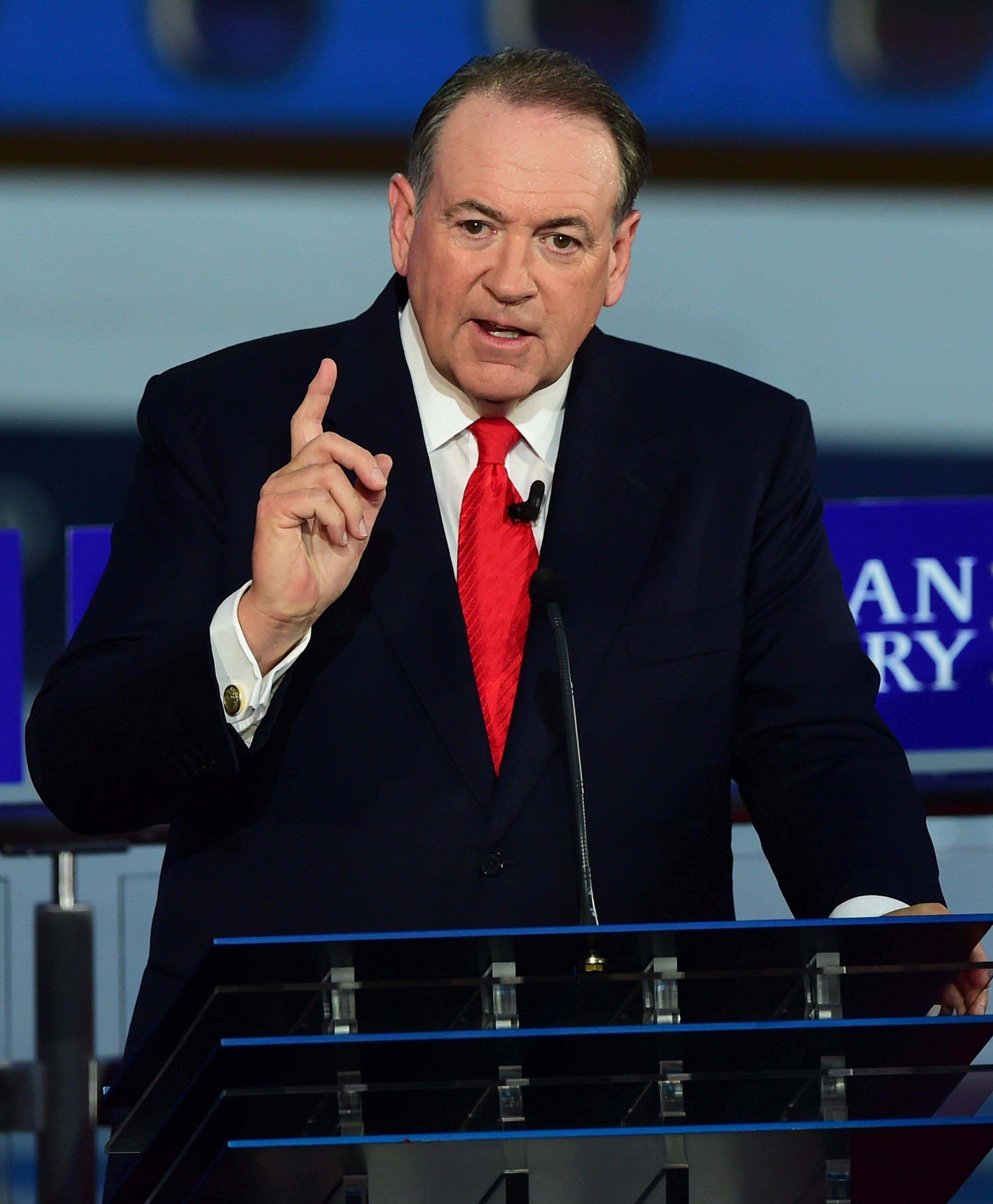 Republican presidential hopeful, former Arkansas Gov. Mike Huckabee gestures  during the Republican presidential debate at the Ronald Reagan Presidential Library in Simi Valley, California on September 16, 2015.  Republican presidential frontrunner Donald Trump stepped into a campaign hornet's nest as his rivals collectively turned their sights on the billionaire in the party's second debate of the 2016 presidential race.  AFP PHOTO / FREDERIC J. BROWN        (Photo credit should read FREDERIC J BROWN/AFP/Getty Images)