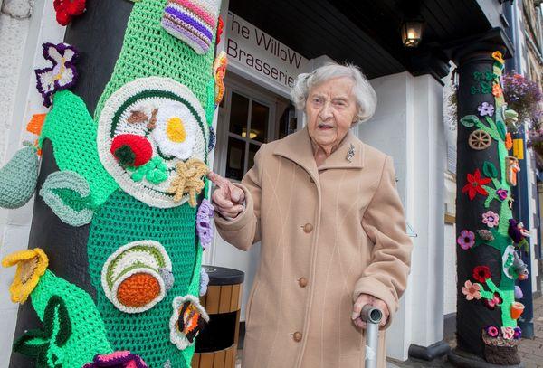 Grace Brett, 104, alongside some of her work.