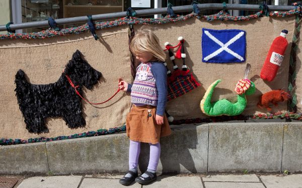 Four-year-old Monica Smith with knitted art in Selkirk, Scotland.