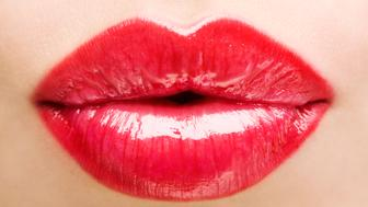 Woman puckering lips, close-up