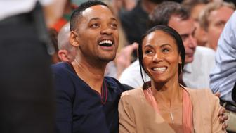 BOSTON, MA - MAY 21:  Actors Will and Jada Pinkett Smith in attendance for the game between the Philadelphia 76ers and  the Boston Celtics in Game Five of the Eastern Conference Semifinals during the 2012 NBA Playoffs on May 21, 2012 at TD Garden in Boston, Massachusetts.  NOTE TO USER: User expressly acknowledges and agrees that, by downloading and or using this photograph, User is consenting to the terms and conditions of the Getty Images License Agreement. Mandatory Copyright Notice: Copyright 2012 NBAE (Photo by Jesse D. Garrabrant/NBAE via Getty Images)