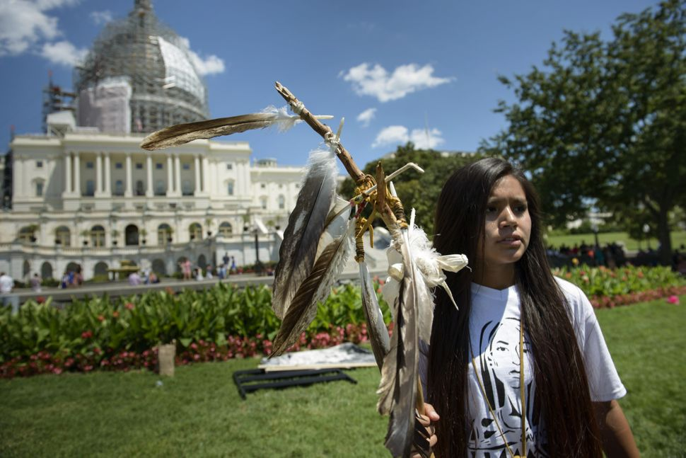 Protestersgathered on Capitol Hill on July 22, to protestCongress' sale of Apache holy land at Oak Flat.