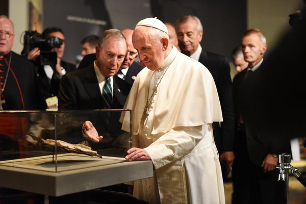Pope Francis walks in the Historic Exhibiion hall of the 911 Museum Memorial with dignitaries including Cardinal Timothy Dola