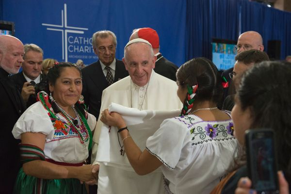Pope Francis receives a gift inside Our Lady Queen of Angels School September 25, 2015 in the East Harlem neighborhood of New