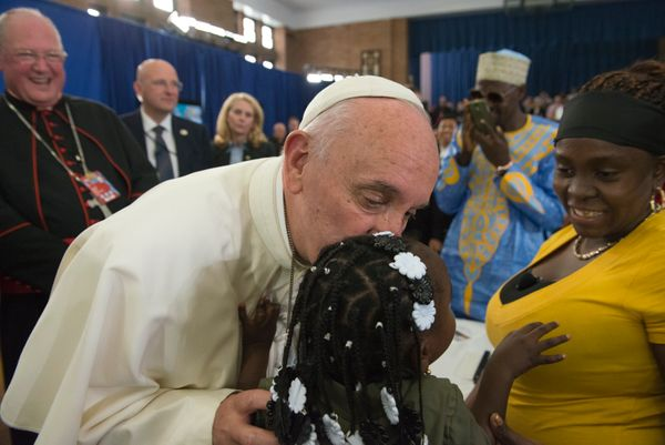 Pope Francis greets people inside Our Lady Queen of Angels School September 25, 2015 in the East Harlem neighborhood of New Y