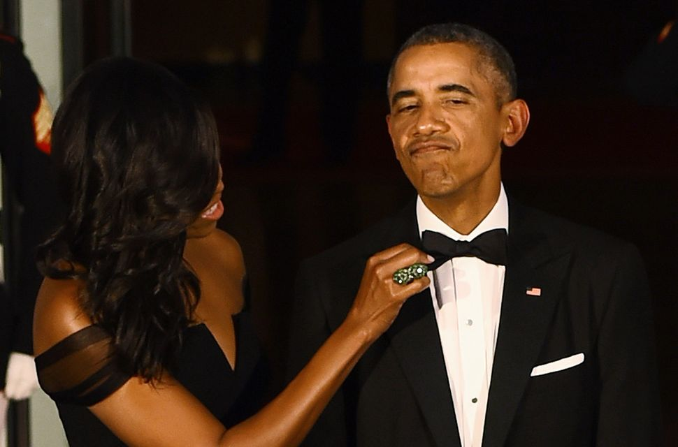 The first lady adjusts the president's bow tie.