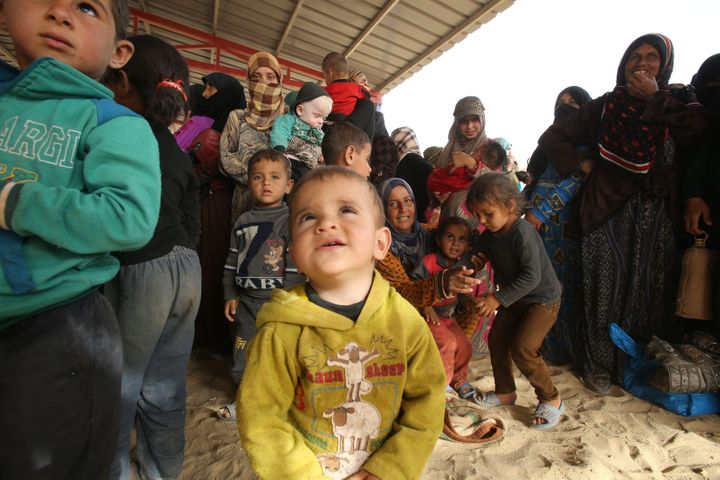 Syrian refugees arrive at the area of Al-Roqban in the desert north-east Jordan, at the border with both Syria and Iraq, on S