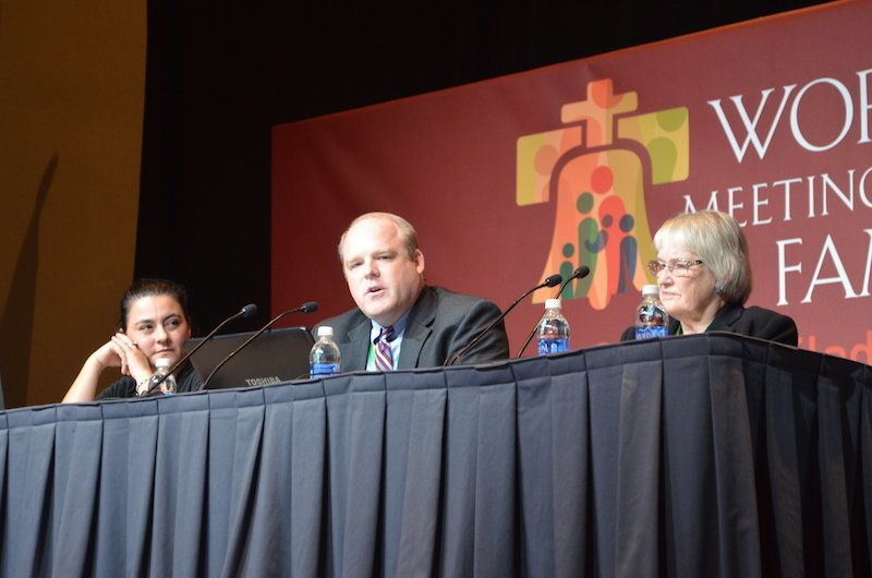 At the World Meeting of Families, Ron Belgau, center, and his mother Beverley Belgau, right, described to a packed room what