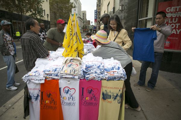 People shop for t-shirts and other memorabilia of Pope Francis and the Festival of Families on September 26, 2015 in Philadel