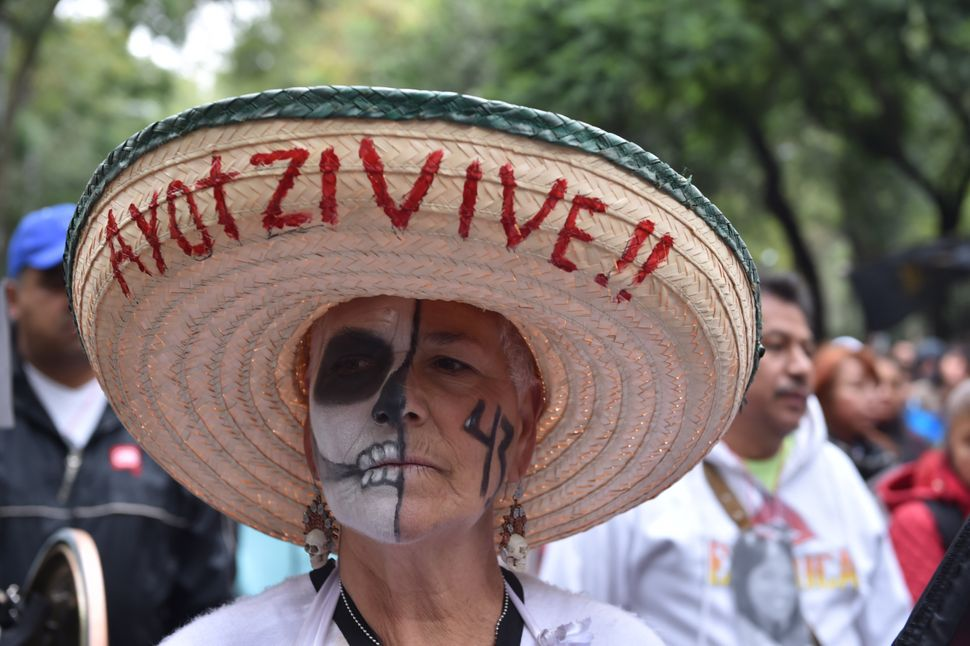 A woman takes part in aprotest in Mexico City on Sept. 26, 2015, to commemorate the first anniversary of Ayotzinapa stu