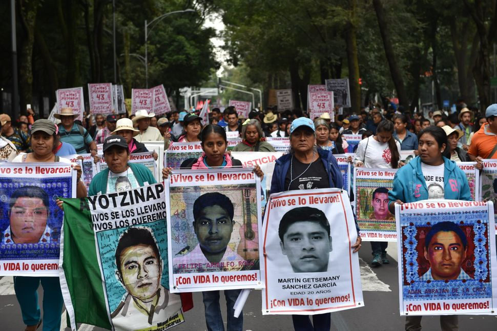 Relatives and supporters of the missing 43 students march through Mexico City Sept. 26, 2015.The students, from a rural