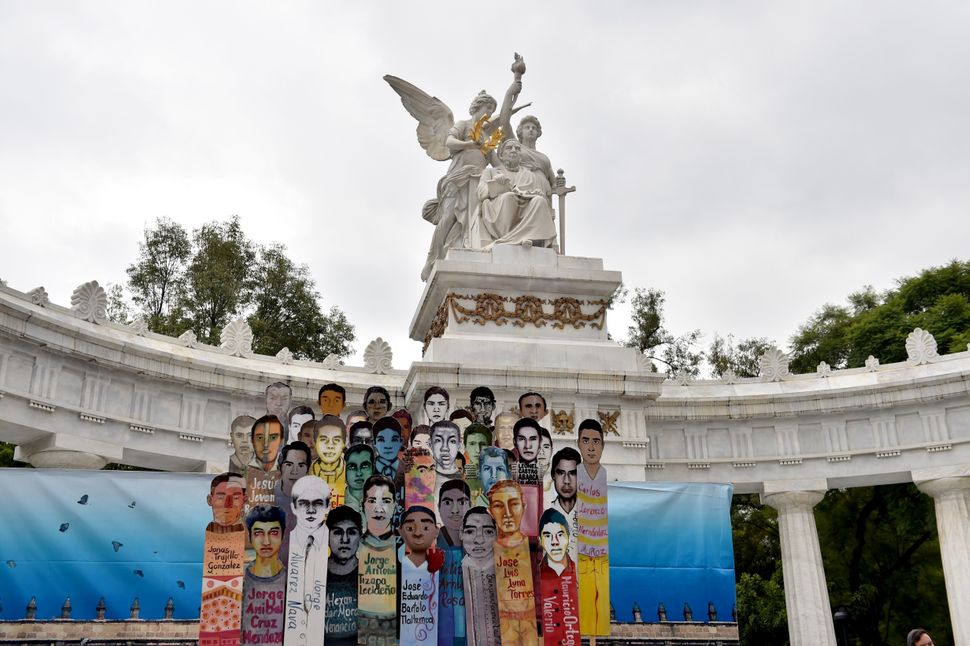 Banners of 43 missing students are displayed during a march in Mexico City to commemorate the anniversary of their disappeara